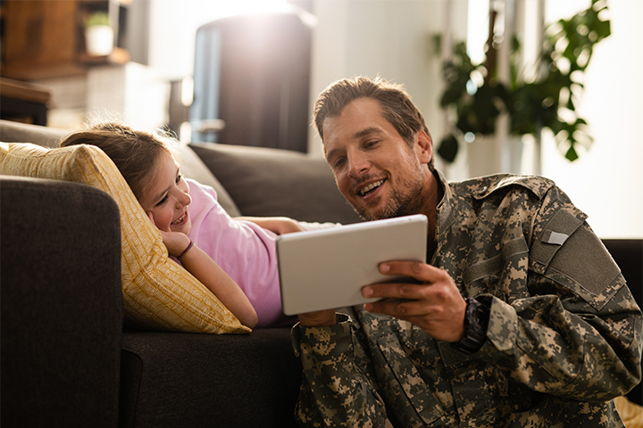 An active service member and daughter using the internet on their tablet