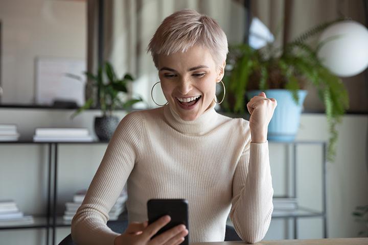 Woman Smiling at Phone Internet Perks